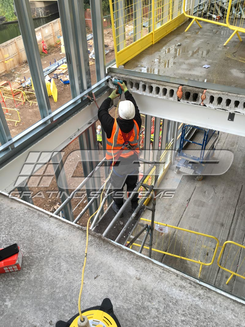 GRP Risergrate installation on site for Galliford Try